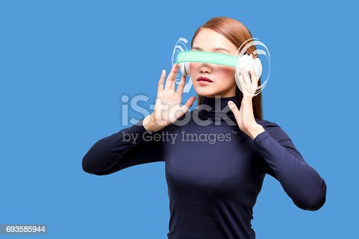 693586040istockphoto woman wearing smart glasses and futuristic graphical user interface 693585944