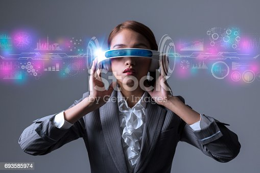 693586040istockphoto woman wearing smart glasses and futuristic graphical user interface 693585974