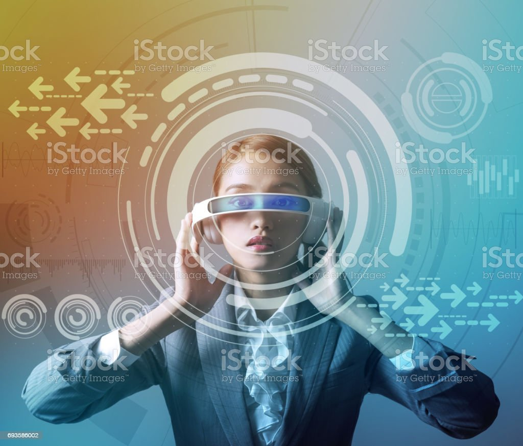 woman wearing smart glasses and futuristic graphical user interface stock photo