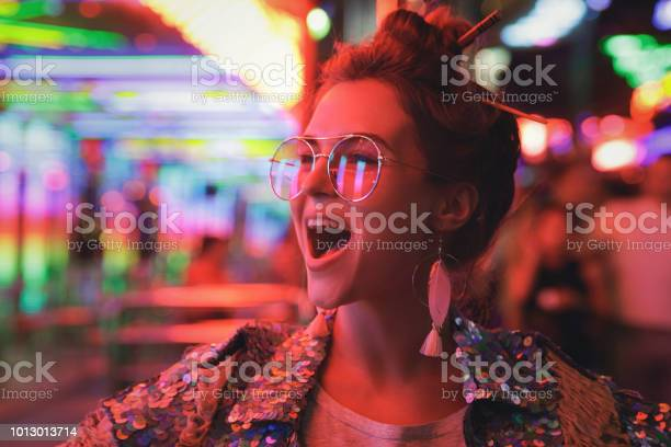 Woman wearing sparkling jacket on the city street with neon lights picture id1013013714?b=1&k=6&m=1013013714&s=612x612&h=ciaif1zjz vtb9koai4 ukatrjcuq609xqyaj8wn7w4=