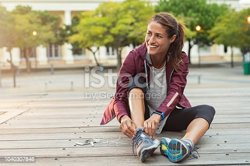 istock Woman wearing sport shoes 1040307846