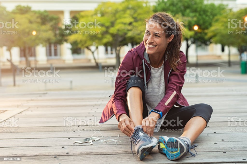 Woman wearing sport shoes stock photo