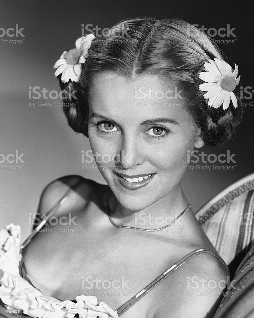 Woman wearing sundress, with flowers in hair royalty-free stock photo