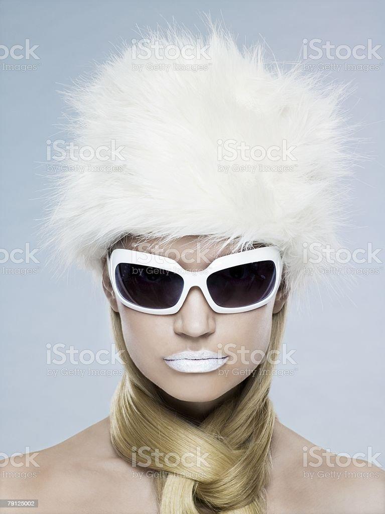 Woman wearing sunglasses and fur hat 免版稅 stock photo