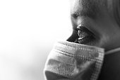 istock Woman wearing surgical face mask for protection during Covid-19 1221962899