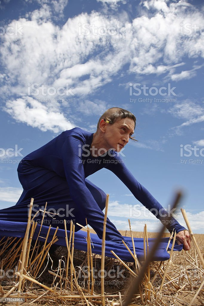 Woman wearing tent dress in cornfield royalty-free stock photo