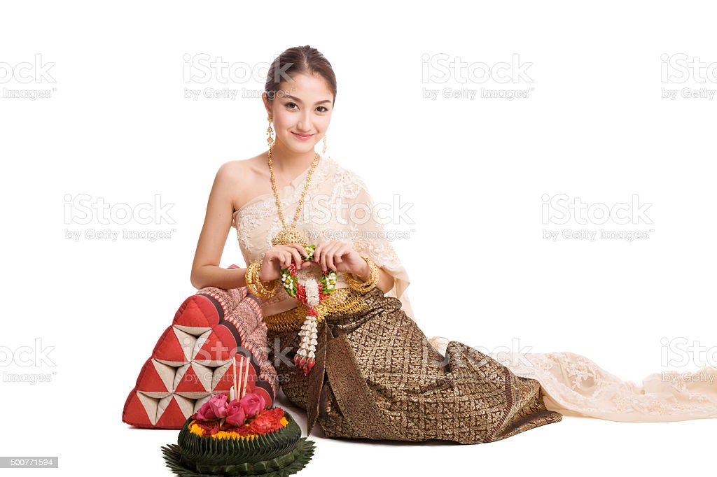 Woman wearing typical thai dress with krathong stock photo