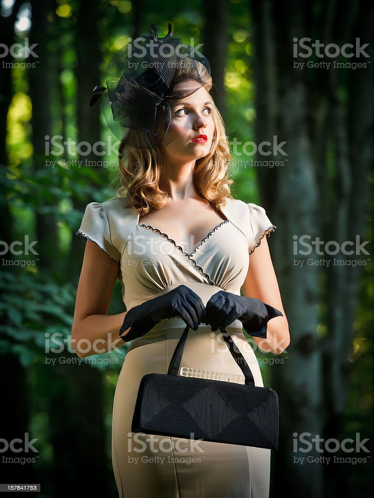 woman wearing vintage clothes lost in the forest royalty-free stock photo