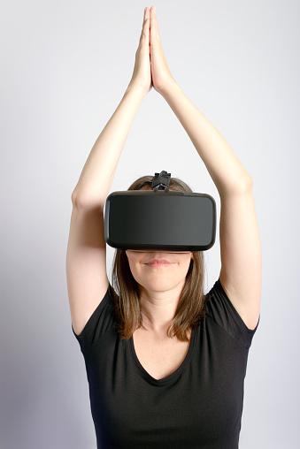 Woman Wearing Virtual Reality Headset Doing Yoga