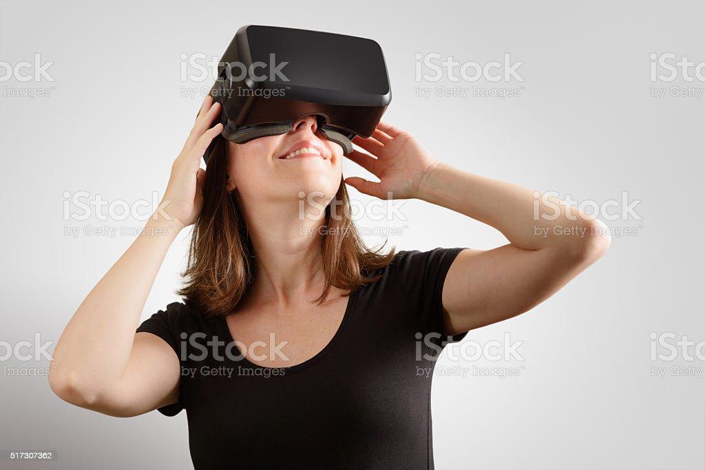 Woman Wearing Virtual Reality Headset stock photo