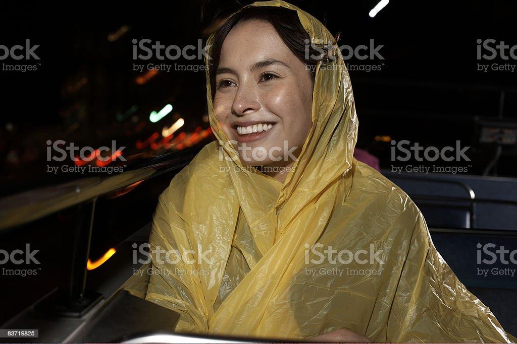 Woman wearing waterproof on open top bus journey royalty free stockfoto