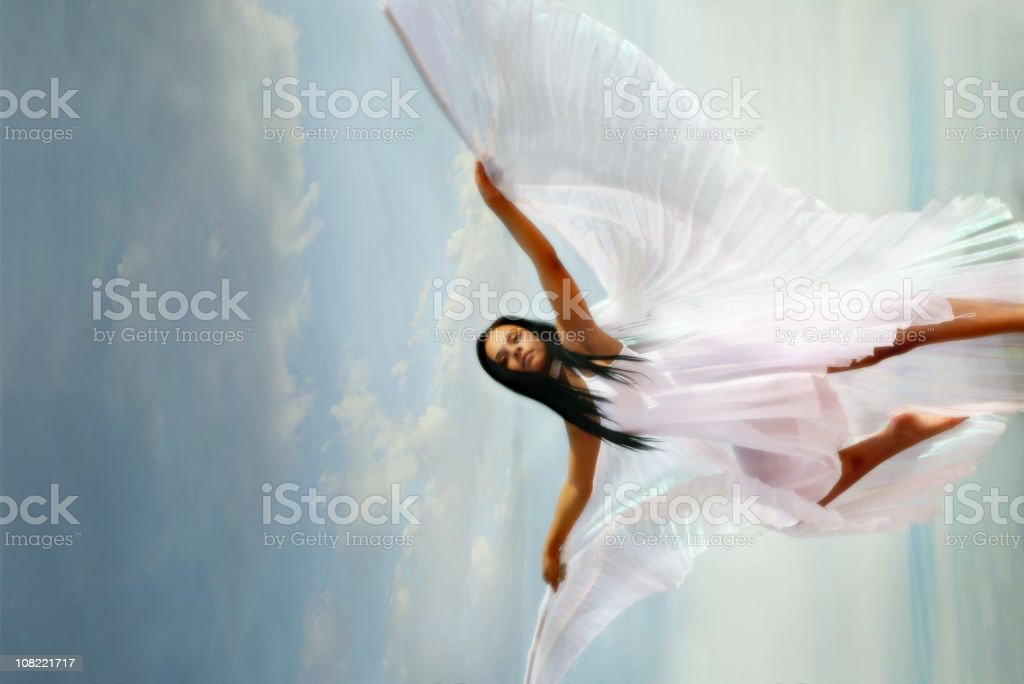 Woman Wearing White Dress with Wings stock photo