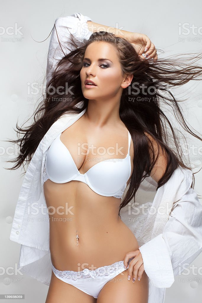 woman wearing white lingerie stock photo
