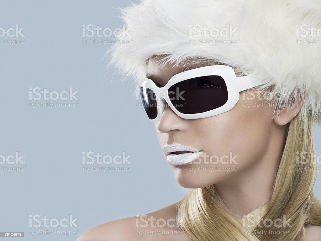 Woman wearing white sunglasses 免版稅 stock photo
