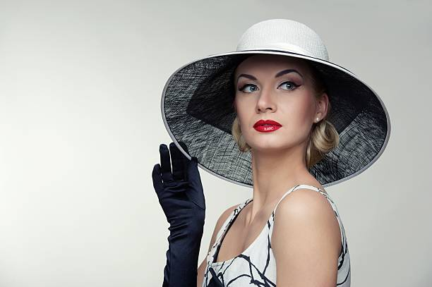 Woman wearing wide-brimmed white hat stock photo
