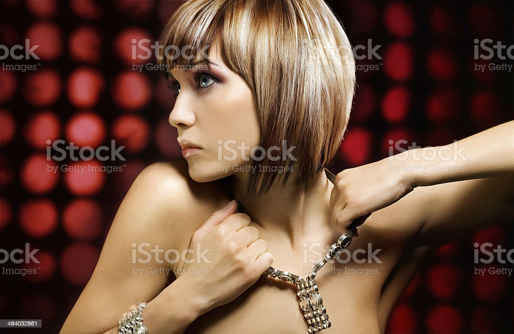 woman weating jewelry against red background royalty-free stock photo