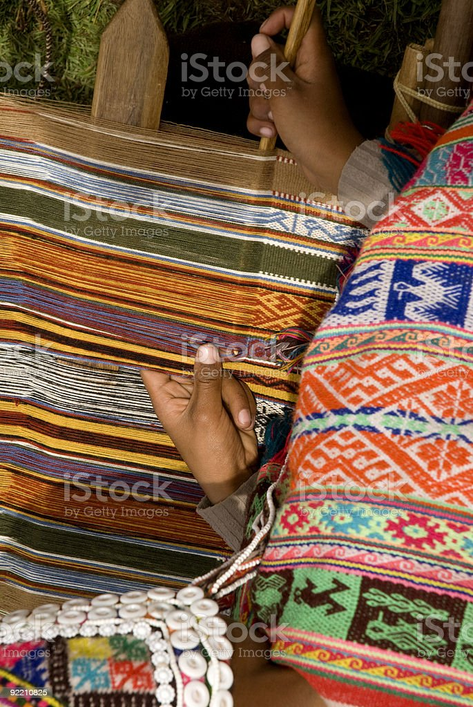 Woman weaving a rug in Peru royalty-free stock photo