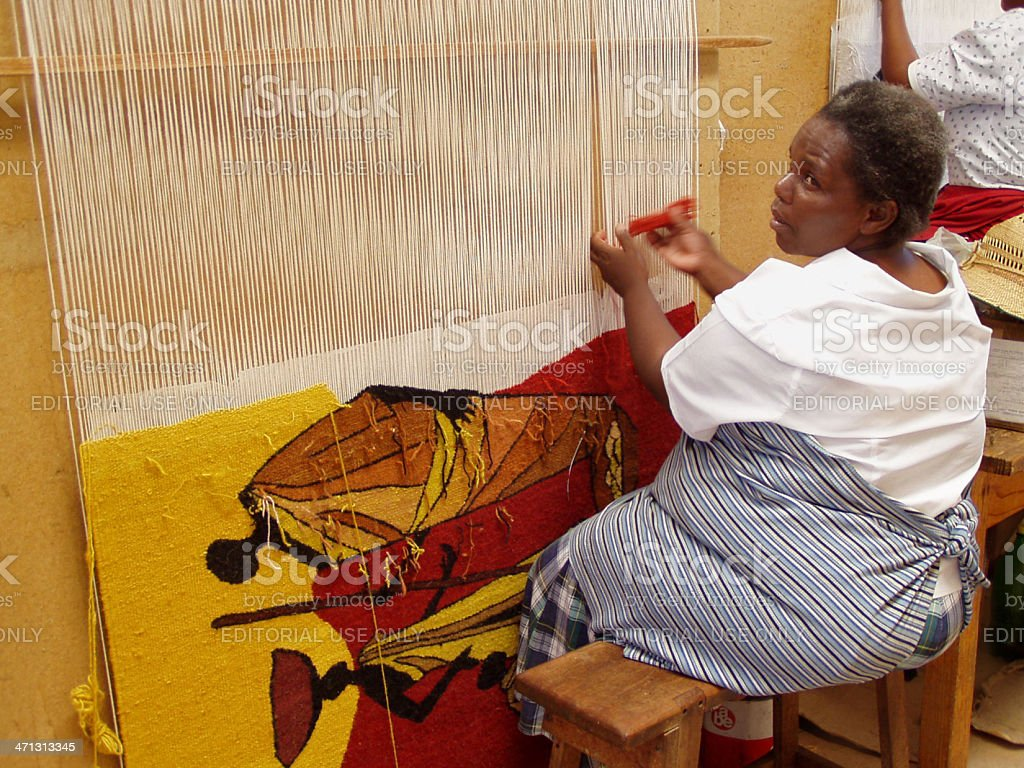 Woman weaving hand made rug in Lesotho stock photo