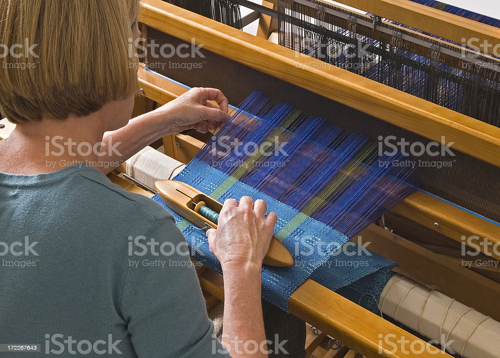 Woman Weaving on a Loom stock photo