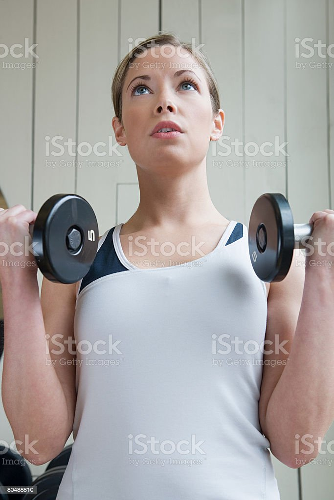 A woman weightlifting royalty-free 스톡 사진