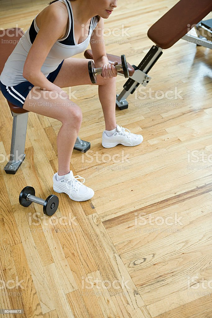 A woman weightlifting royalty-free stock photo