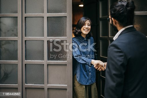 istock Woman welcoming financial adviser 1185440562