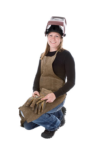 Woman welder crouching with gloves and maskisolated on white stock photo