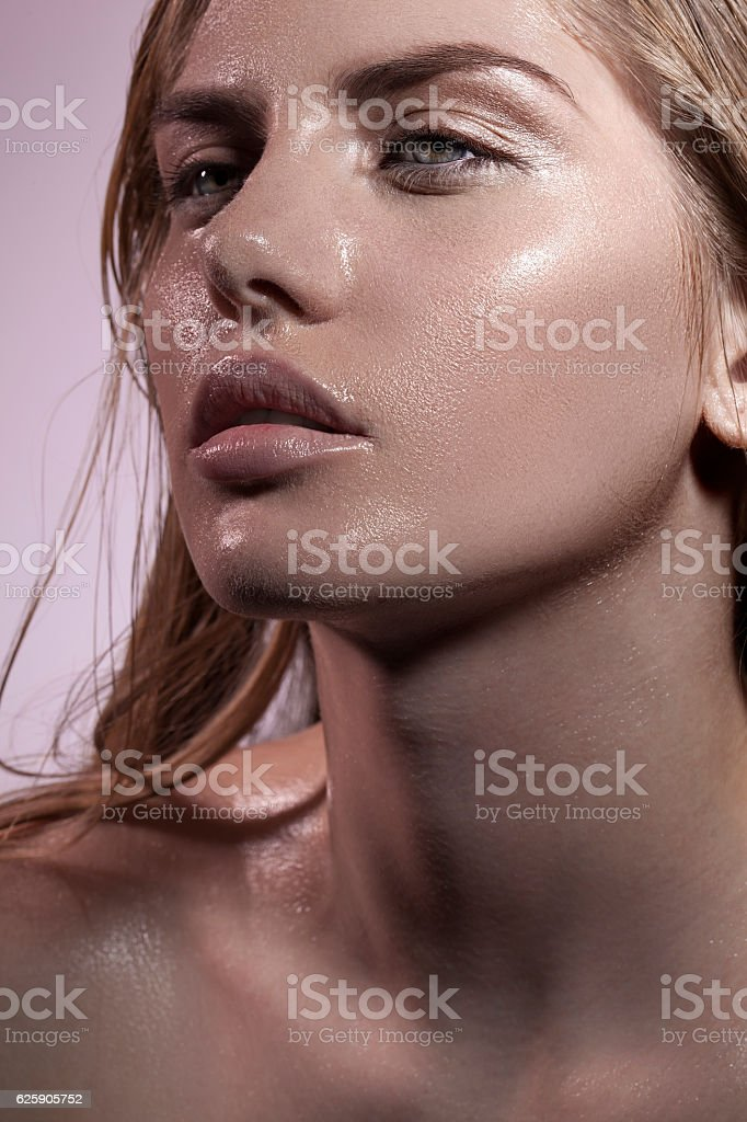 woman wet face stock photo
