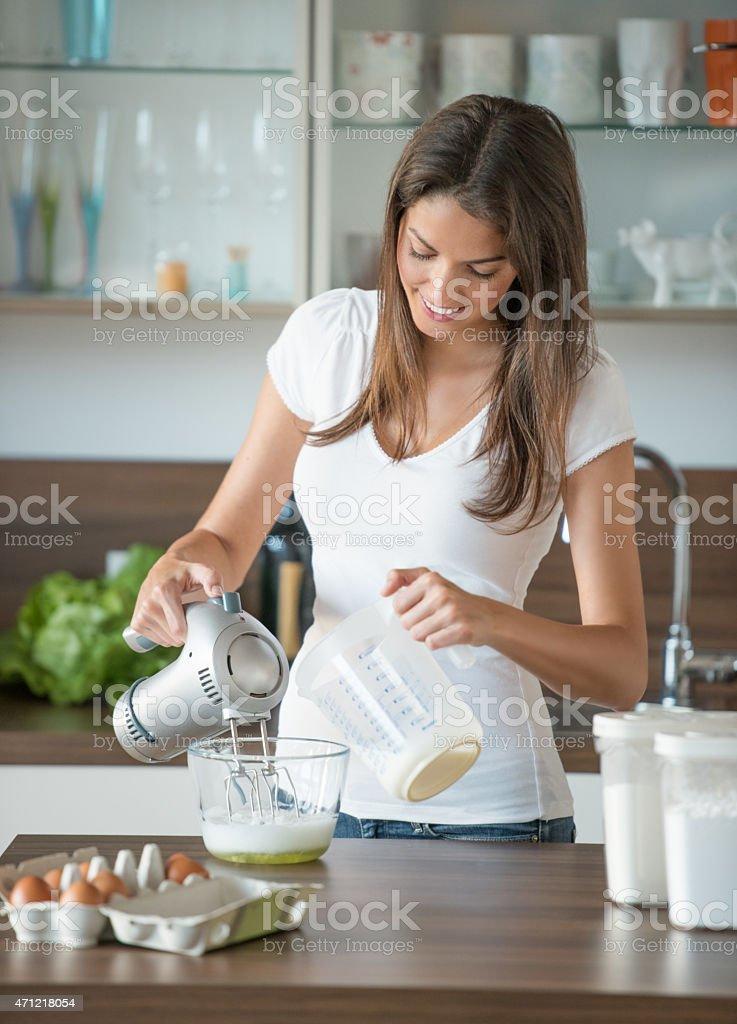 Woman Whisking stock photo
