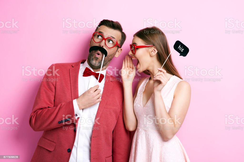 Woman whispering a secret to her boy stock photo