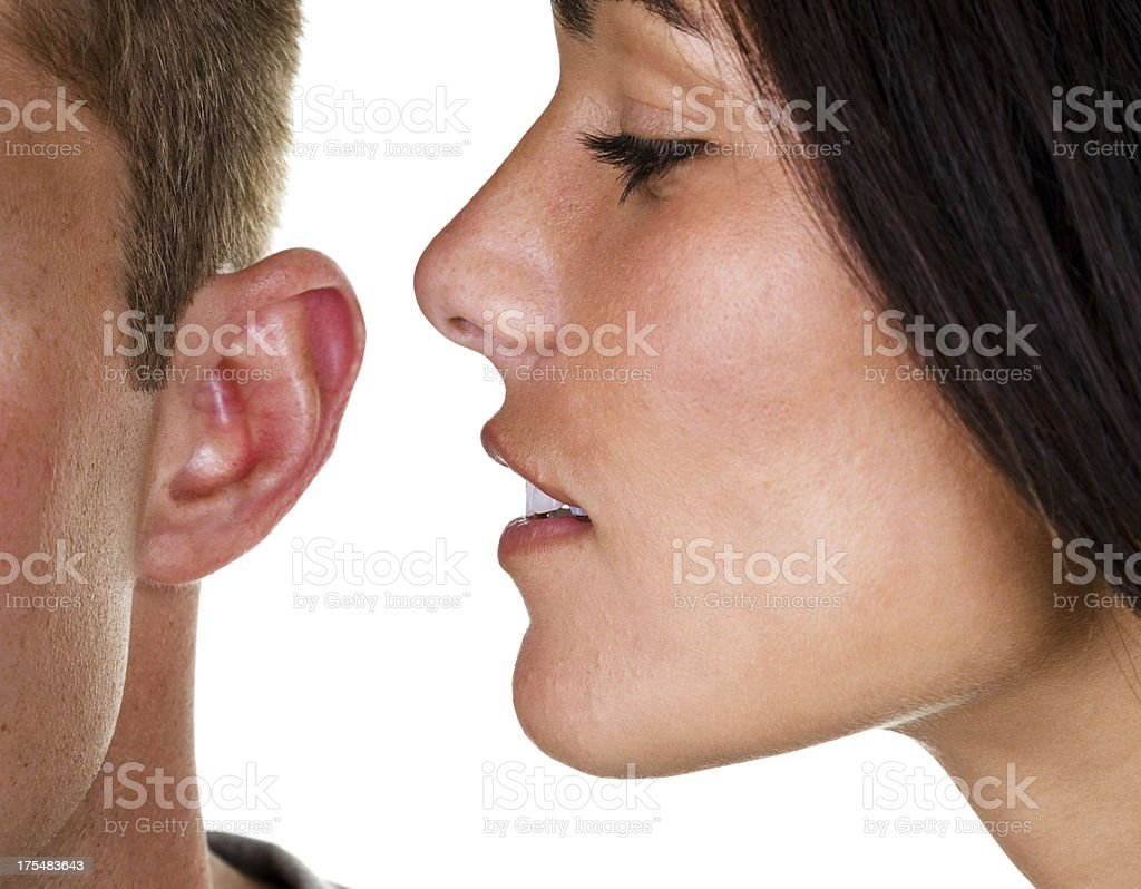 woman whispering in mans ear stock photo amp more pictures
