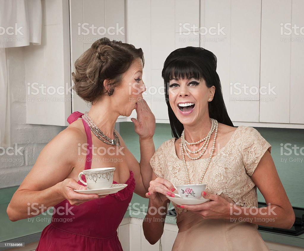 Woman Whispers Joke royalty-free stock photo