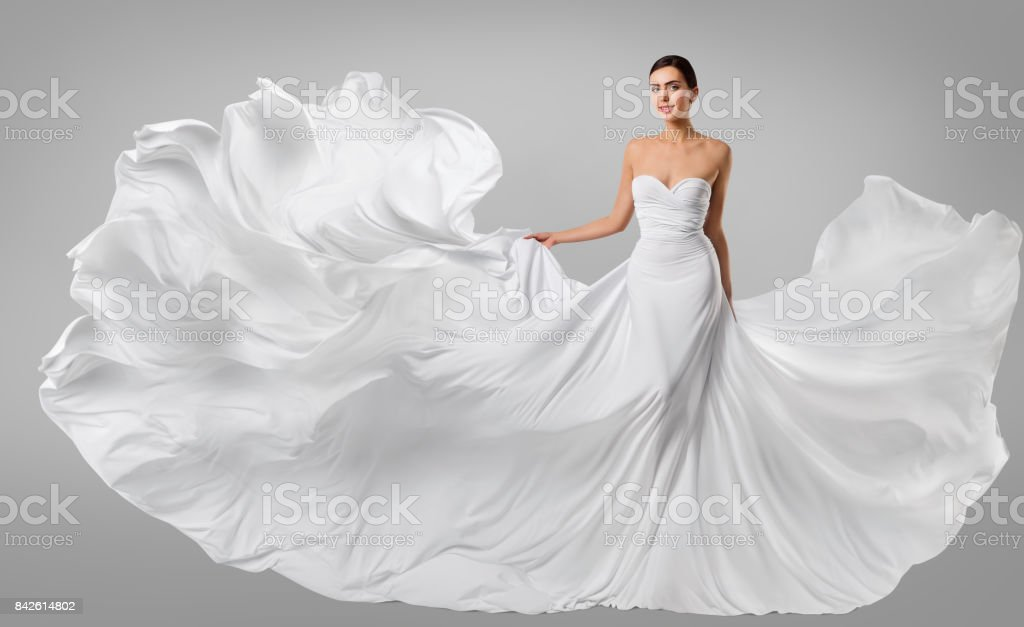 Woman White Dress, Fashion Model in Long Silk Gown, Waving Flying Fabric, Fluttering on Wind stock photo