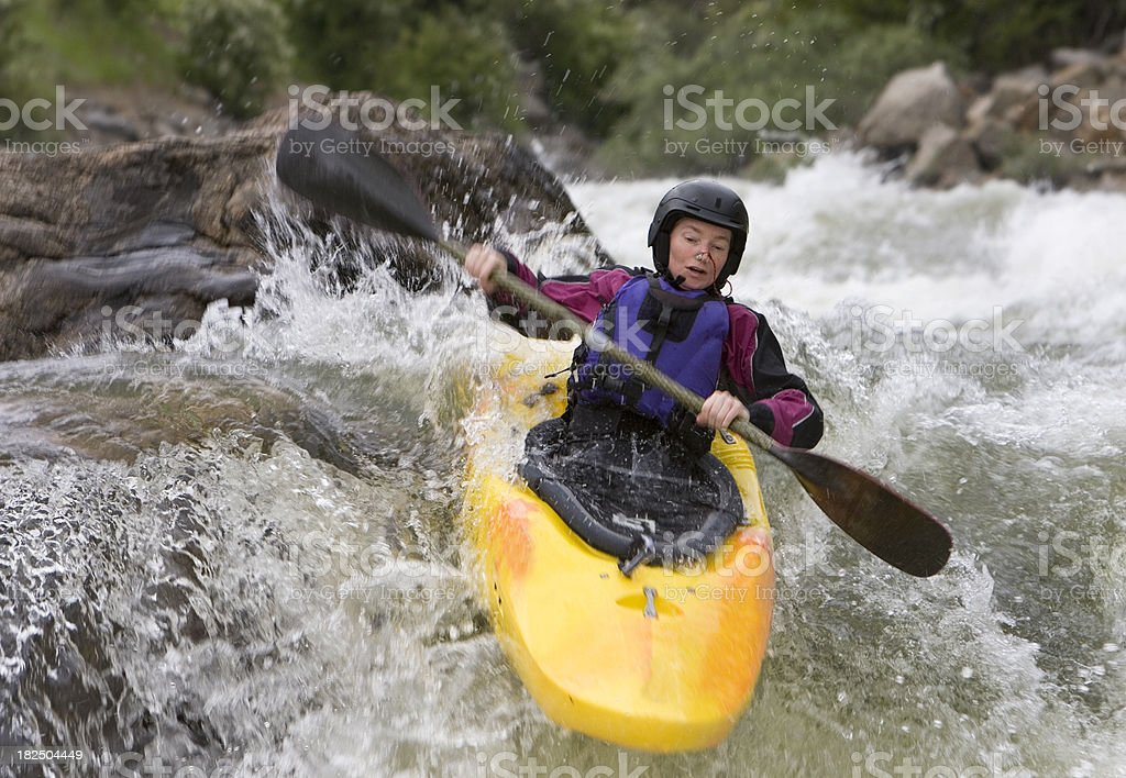Woman White Water Kayaking royalty-free stock photo