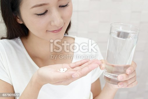 istock Woman who drinks supplements 637901672