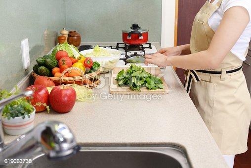 619063596 istock photo Woman who enjoys cooking 619063738