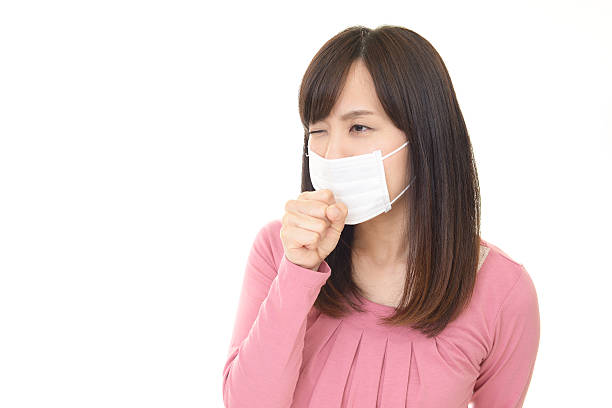woman who has a cold - マスク 日本人 ストックフォトと画像