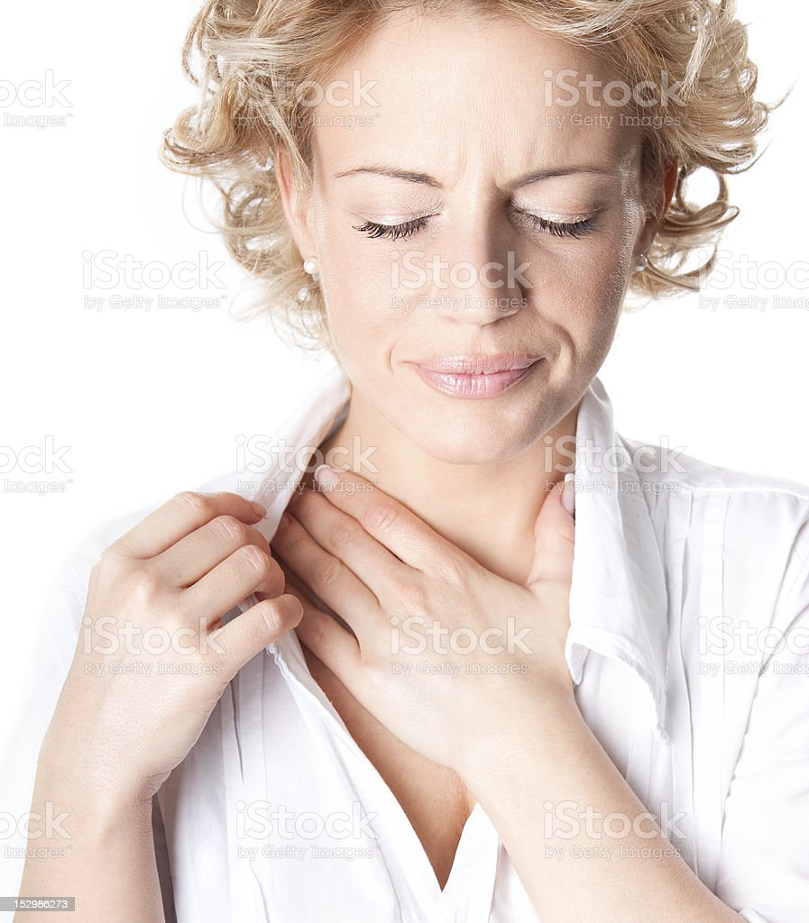 woman who has chest pain stock photo