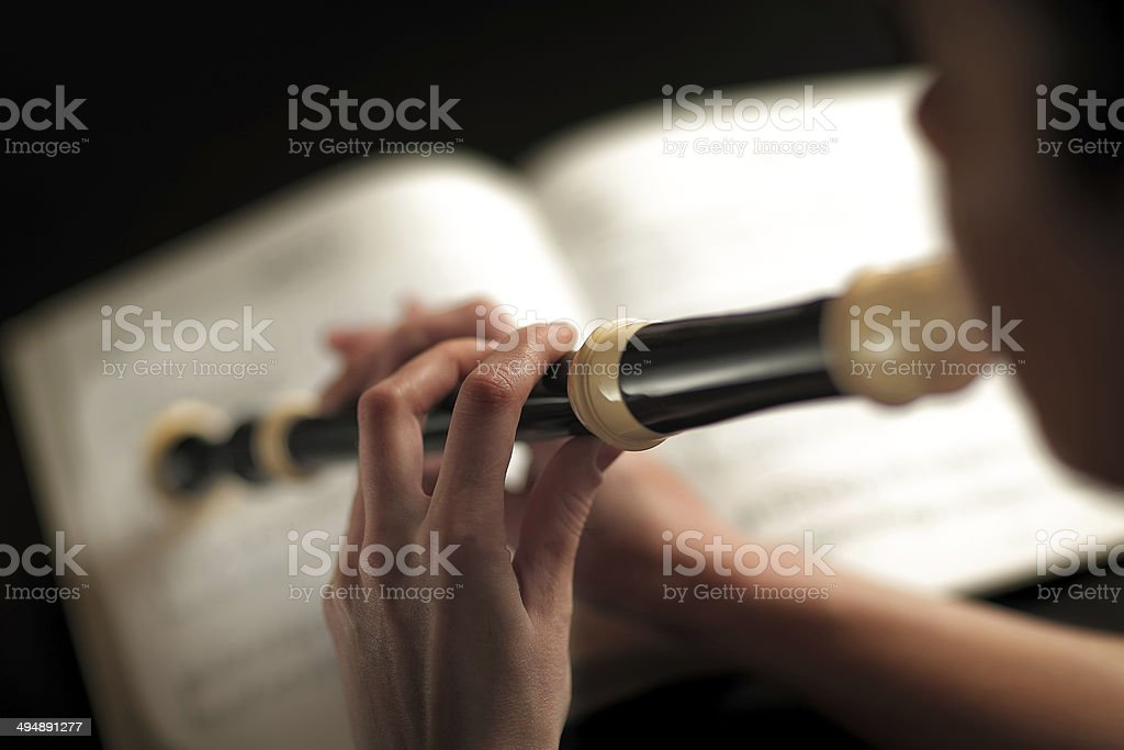woman who plays the flute stock photo