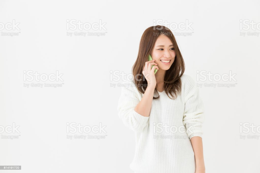 woman who talks on the telephone stock photo