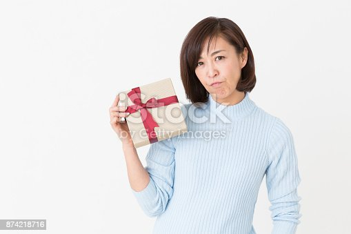 874218810 istock photo woman who thinks while having a present 874218716
