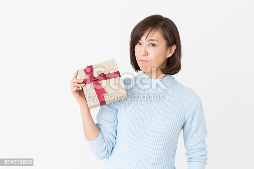 874218810 istock photo woman who thinks while having a present 874218826