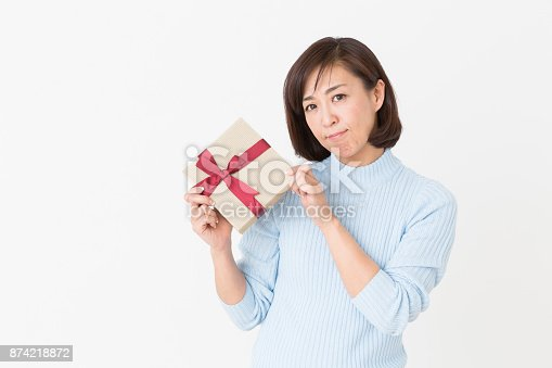 874218810 istock photo woman who thinks while having a present 874218872