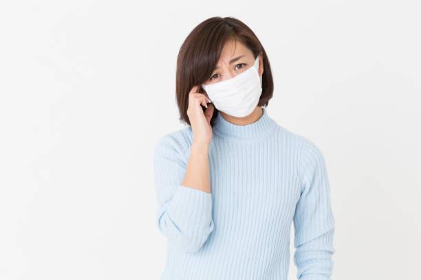 kvinnan som bar en mask - mature woman fever on white bildbanksfoton och bilder