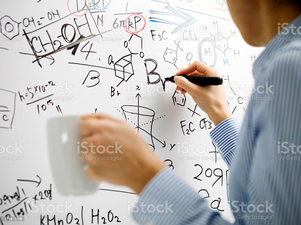Woman who writes a formula to white board royalty-free stock photo