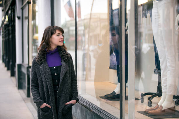 Woman Window Shopping in a City Downtown Mall stock photo