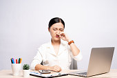 Woman wipe her nose at office isolated white background