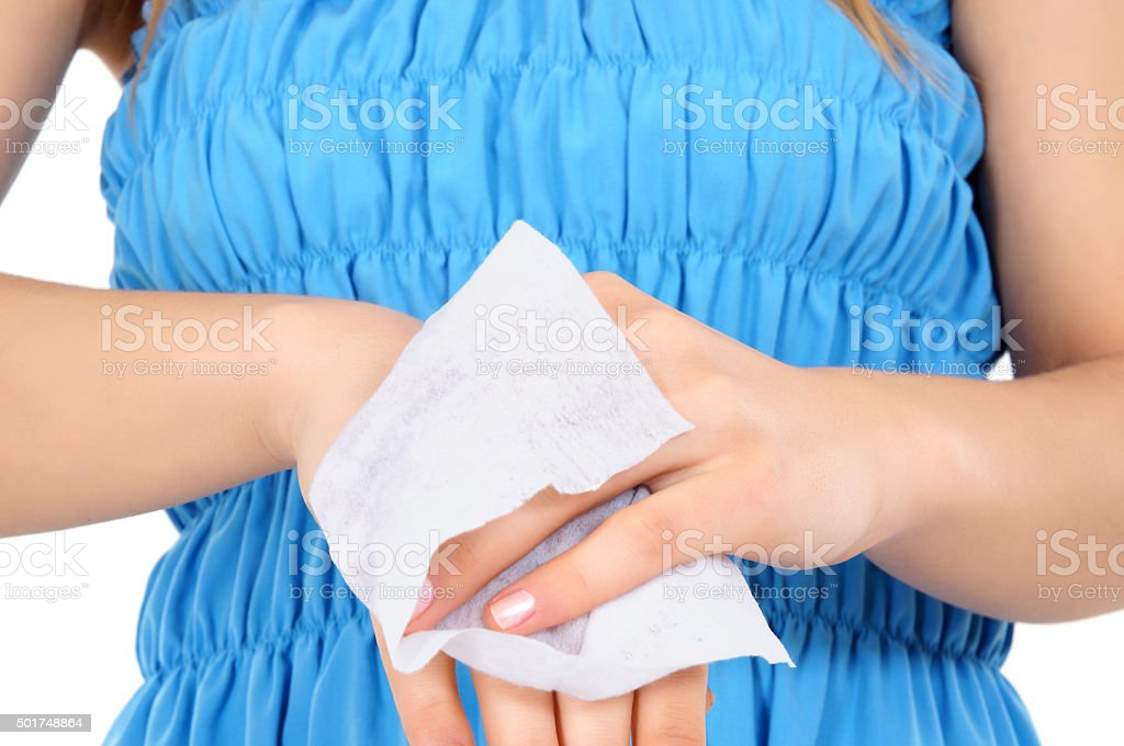 woman wipes her hands stock photo