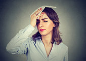 istock woman wipes sweat from her forehead with a handkerchief 820859902