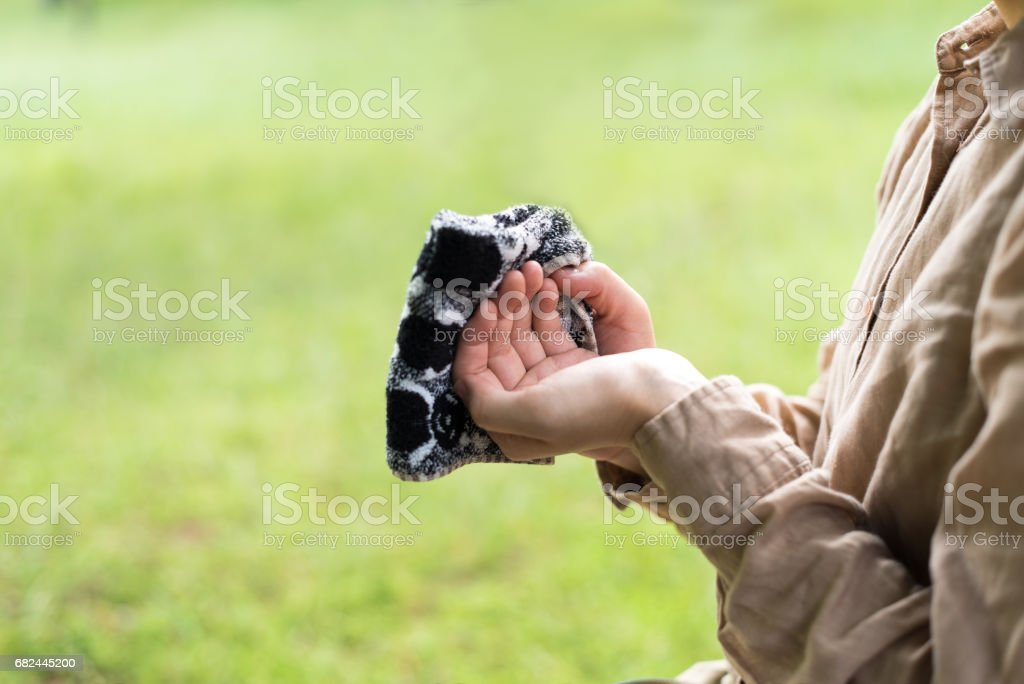 Woman wiping my hands with a handkerchief royalty-free stock photo